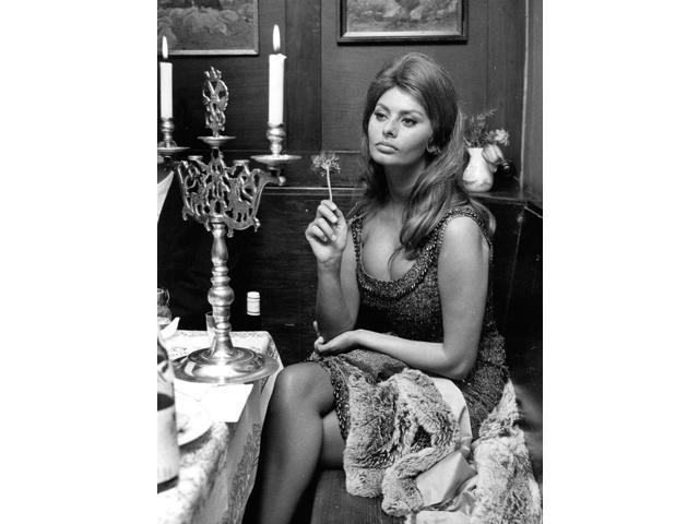 Sophia Loren Sitting At A Table Photo Print (8 X 10