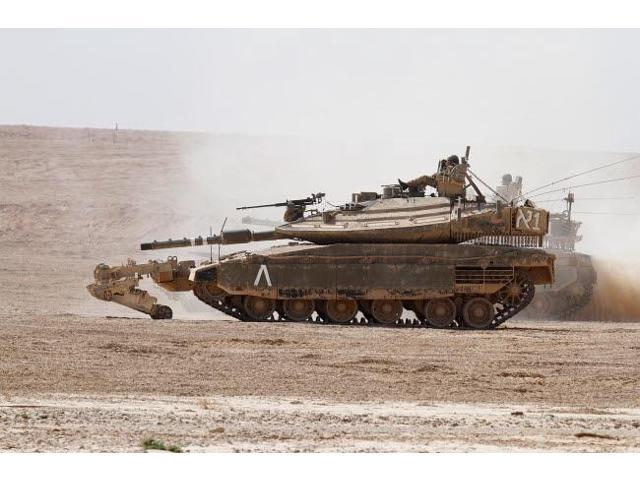 An Israel Defense Force Merkava Mark IV battle tank with mine clearing device Poster Print by Ofer ZidonStocktrek Images (17 x 11)