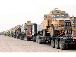 A convoy of Mine-Resistant Ambush Protected vehicles ready for departure Poster Print by Stocktrek Images (17 x 11)