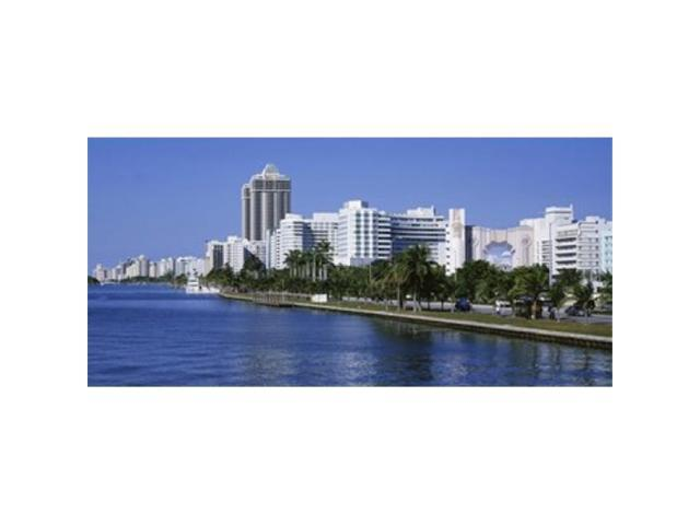 Panoramic Images PPI68913L USA Florida Miami Miami Beach Panoramic view of waterfront and skyline Poster Print by Panoramic Images - 36 x 12 (Arts & Entertainment Artwork) photo