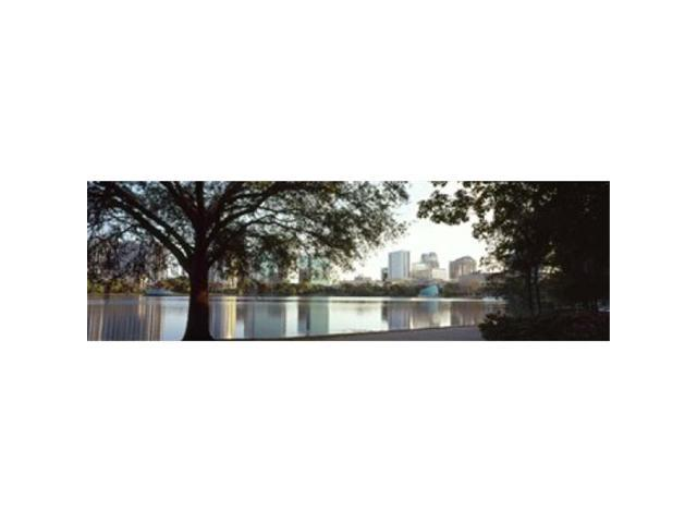 Panoramic Images PPI127699L Buildings at the waterfront Lake Eola Orlando Orange County Florida USA Poster Print by Panoramic Images - 36 x 12 (Arts & Entertainment Artwork) photo