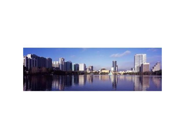 Panoramic Images PPI127704L Buildings at the waterfront Lake Eola Orlando Orange County Florida USA 2010 Poster Print by Panoramic Images - 36. (Arts & Entertainment Artwork) photo