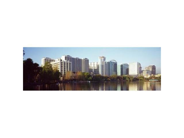 Panoramic Images PPI127700L Buildings at the waterfront Lake Eola Orlando Orange County Florida USA Poster Print by Panoramic Images - 36 x 12 (Arts & Entertainment Artwork) photo