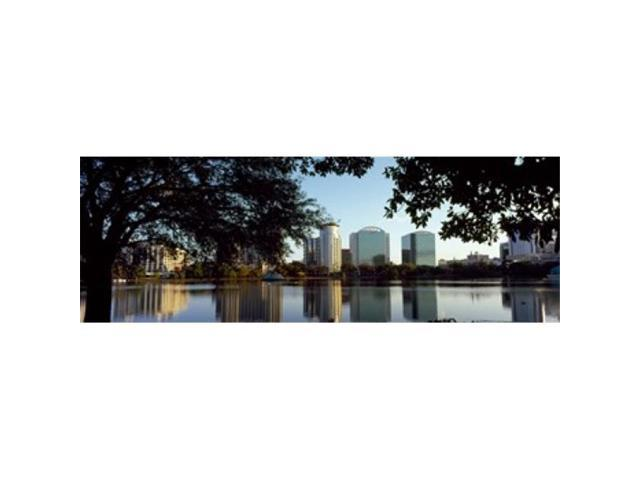 Panoramic Images PPI127698L Buildings at the waterfront Lake Eola Orlando Orange County Florida USA Poster Print by Panoramic Images - 36 x 12 (Arts & Entertainment Artwork) photo