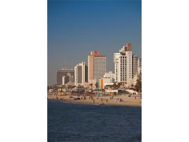 Danita Delimont PDDAS14WBI0509 Israel Tel Aviv Beachfront Hotels Late Afternoon Poster Print by Walter Bibikow, 19 x 28 (Toys & Games Toys Educational Toys) photo