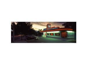 Panoramic Images PPI77825L Restaurant lit up at dusk  Route 66  Albuquerque  Bernalillo County  New Mexico  USA Poster Print by Panoramic Images - 36 x 12