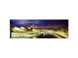 Panoramic Images PPI70283L Buildings lit up at dusk  Guggenheim Museum Bilbao  Bilbao  Vizcaya  Spain Poster Print by Panoramic Images - 36 x 12