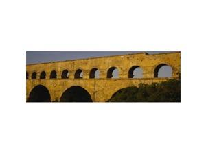 Panoramic Images PPI58742L High section view of an ancient aqueduct  Pont Du Gard  Nimes  Provence  France Poster Print by Panoramic Images - 36 x 12