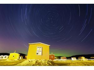 Star Trails And Ice Fishing Huts On Saguenay River; Saguenay Lac-Saint-Jean Quebec Canada Poster Print (18 x 12)