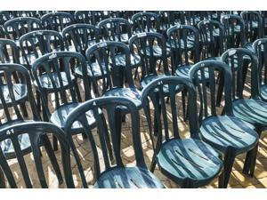 Plastic green chairs lined up in rows Malaga Province Andalusia Spain Poster Print (19 x 12)