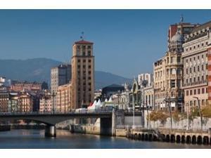 Riverfront Buildings, Bilbao, Spain Poster Print by Walter Bibikow (18 x 12)