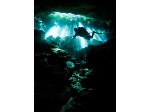 A cavern diver enters the Taj Mahal cenote system on Mexicos Yucatan Peninsula Poster Print by Karen DoodyStocktrek Images (11 x 17)