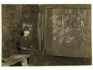 Vance a Trapper Boy 15 years old Has trapped for several years in a West Va Coal mine 75 a day for 10 hours work All he does is to open and shut this door most of the time he sits here idle waiting fo