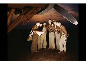 A combat crew receives final instructions just before taking off in a mighty YB-17 bomber from a bombardment squadron base at the field Langley Field Va Poster Print by unknown (18 x 24)