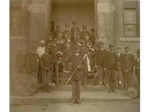 African American band posed on steps to brick building Poster Print (18 x 24)