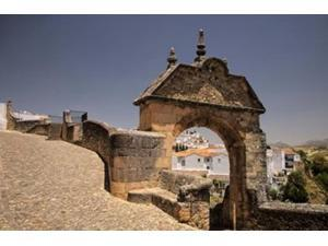 Spain, Andalusia, Malaga Province, Ronda Stone Archway Poster Print by Julie Eggers (19 x 12)