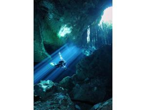 Diver silhouetted in sunrays of cenote system on Mexicos Yucatan Peninsula Poster Print by Karen DoodyStocktrek Images (11 x 17)
