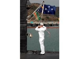 Sailor hauls down the commissioning pennant for the fast attack submarine USS Salt Lake City Poster Print by Stocktrek Images (11 x 17)