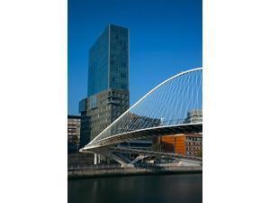 Spain, Bilbao, Zubizuri Bridge over Rio de Bilbao Poster Print by Walter Bibikow (18 x 24)