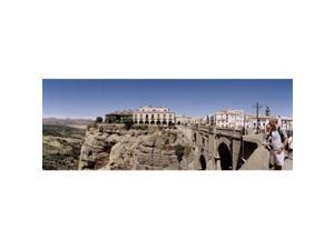 Panoramic Images PPI106309L Tourists standing on a bridge  Puente Nuevo  Ronda  Malaga Province  Andalusia  Spain Poster Print by Panoramic Images - 36 x 12