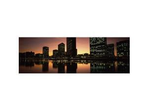 Panoramic Images PPI115402L Buildings lit up at dusk  Oakland  Alameda County  California  USA Poster Print by Panoramic Images - 36 x 12