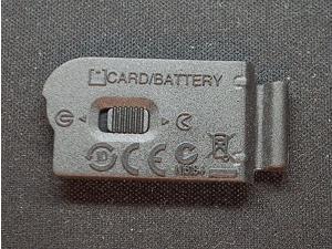 Nikon Genuine Battery Door Cover Lip For Nikon 1 J1 Camera Body