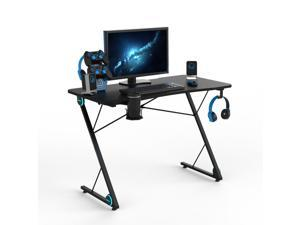 Bestoss 43.3 inch Gaming Desk, Z-Shaped Professional E-Sport Gamer Workstation with LED Lights & Large Carbon Fiber Surface, Ergonomic PC Gaming Table for Home Office