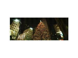 Panoramic Images PPI129785L Christmas tree lit up at night  Rockefeller Center  Manhattan  New York City  New York State  USA Poster Print by Panoramic Images - 36 x 12