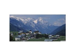 Panoramic Images PPI47889L High angle view of a village on a landscape and a mountain range in the background  St. Anton  Austria Poster Print by Panoramic Images - 36 x 12