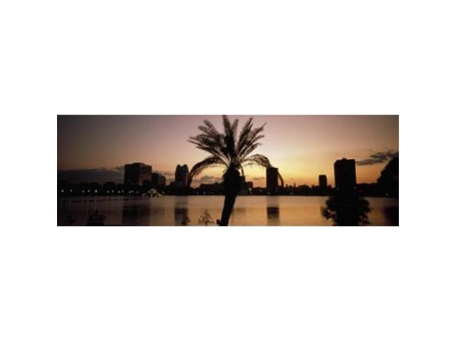 Panoramic Images PPI58577L Silhouette of buildings at the waterfront Lake Eola Summerlin Park Orlando Orange County Florida USA Poster Print. (Arts & Entertainment Arts & Crafts) photo